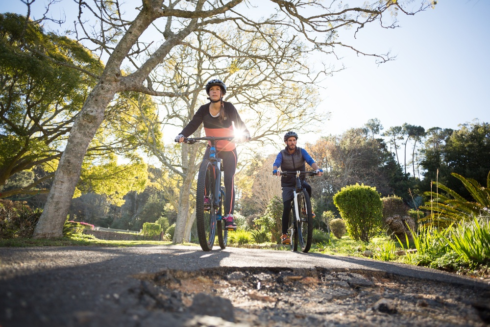 Two people enjoying the Topeka trails on their bikes